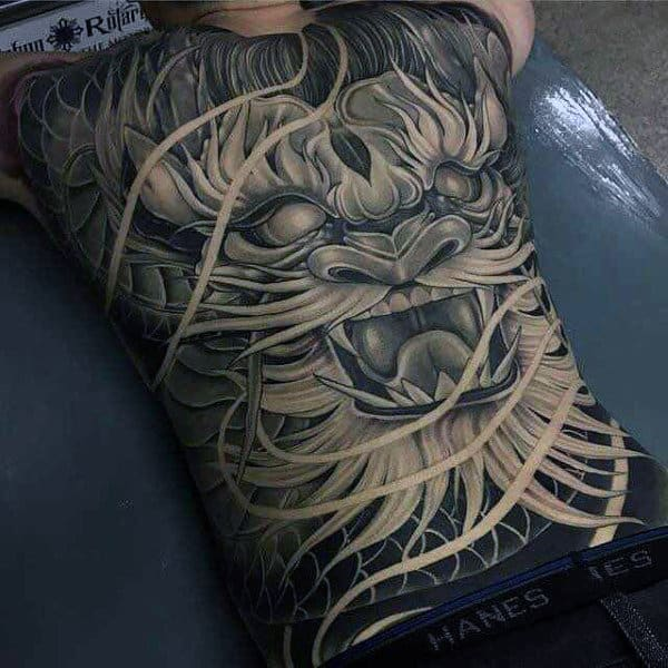 Guy Wtih Squiggly Hairy Demon Face Tattoo Full Back
