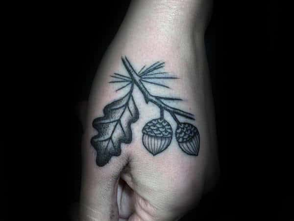 Guys Acorn Tattoo On Hand With Dotwork And Black Ink Design