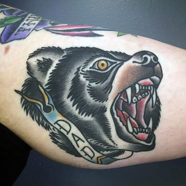 Guys Arms Growling Animal And Dad Tattoo