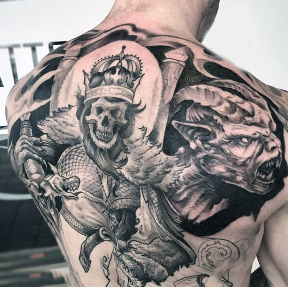 Guys Back Violent Bearded Skull With Crown Tattoo