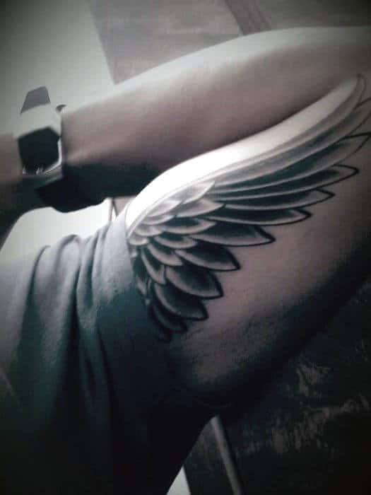 Guys Bicep Tribal Wings Tattoos