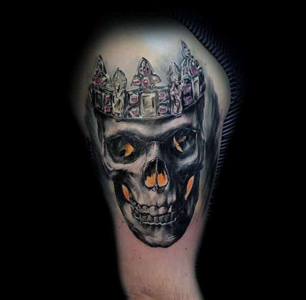 Guys Biceps Skull With Bejewelled Crown Tattoo