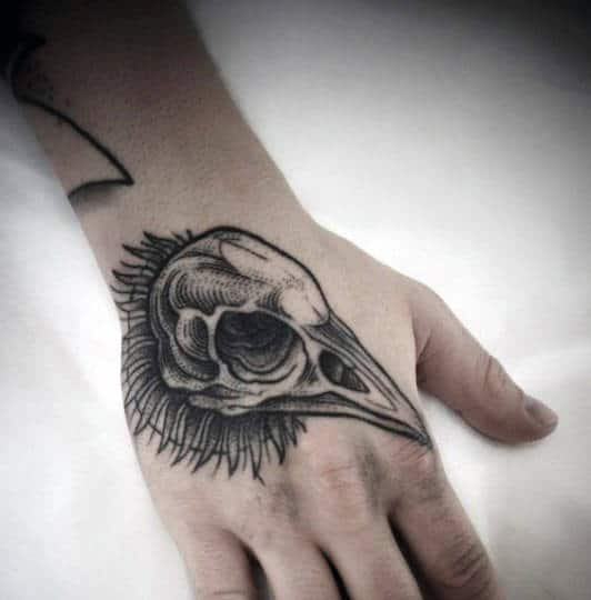 Guys Bird Skull Hand Tattoos