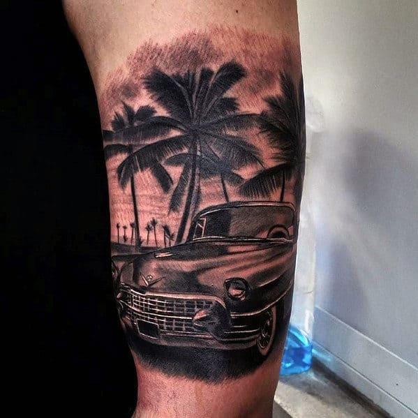 Guys Cadillac Car With Beach Scene Quarter Sleeve Tattoo