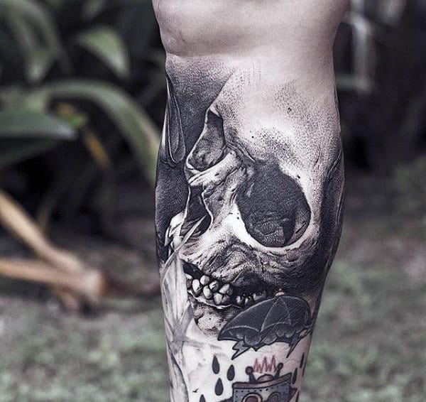 Guys Calves Interesting Skull Tattoo
