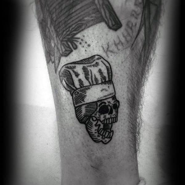 Guys Calves Small Skull Wearing Chef Culinary Tattoo
