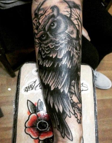 Guy's Celtic Owl Tattoo On Forearm