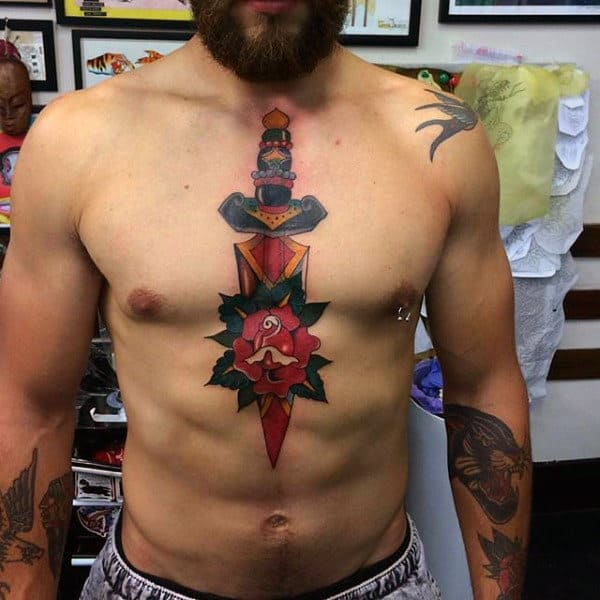 Guys Chest Dagger Into Rose Tattoo