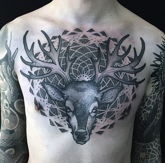 Guys Chest Horned Beast Pattern Tattoo