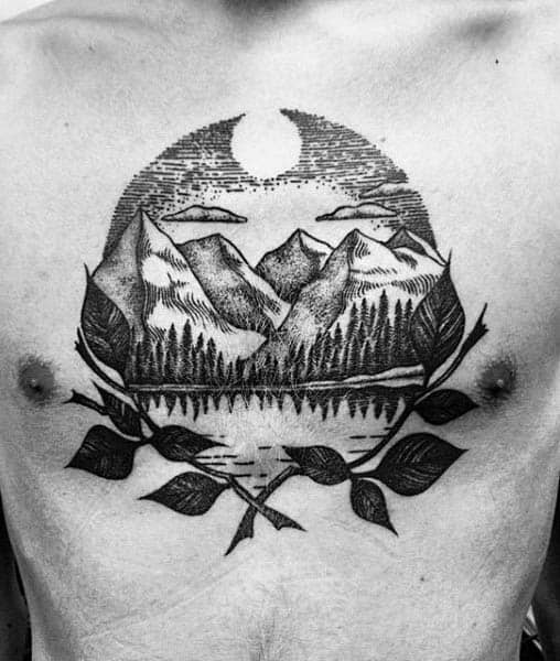 Guys Chest Tattoo Of Negative Space Sun Tattoo With Mountains And Tree Branches