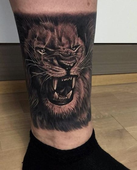 Guy's Chinese Lion Tattoo On Lower Leg