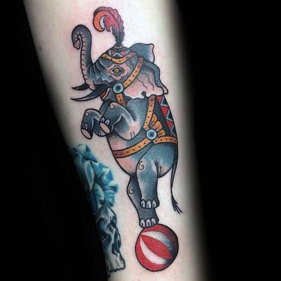 Guys Circus Tattoo With Elephant Design On Forearm
