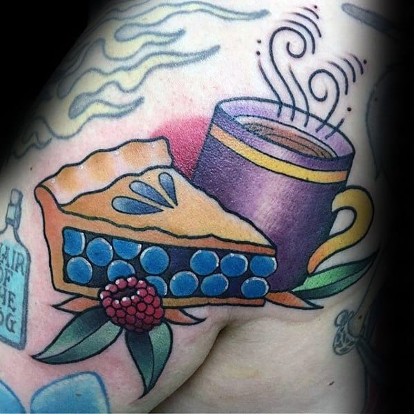 Guys Coffee Cup With Blueberry Pie Slice Shoulder Tattoos
