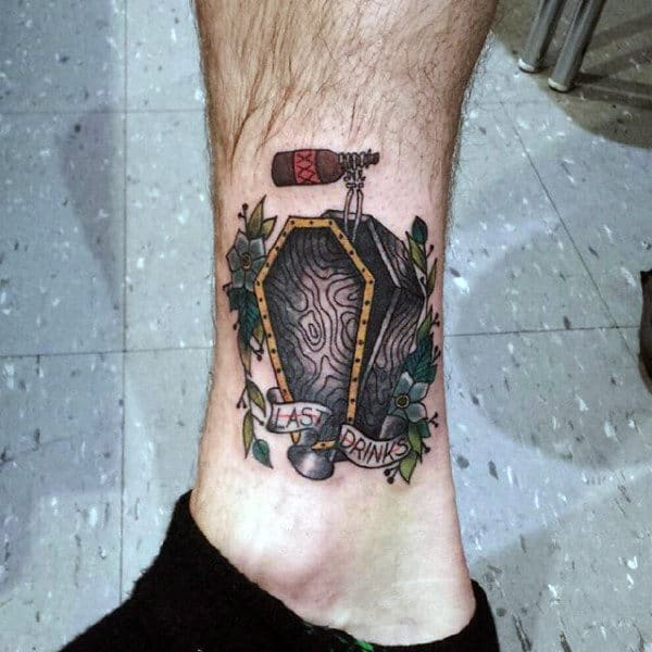 Guys Coffin Tattoo On Leg With Skeleon Hand Holding Beer