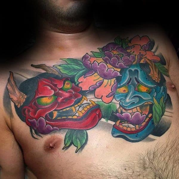 guys-colorful-hannya-masks-tattoo-on-upper-chest