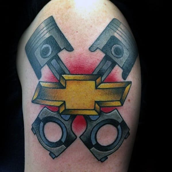 Guys Crossed Pistons With Chevy Logo Traditional Upper Arm Tattoo
