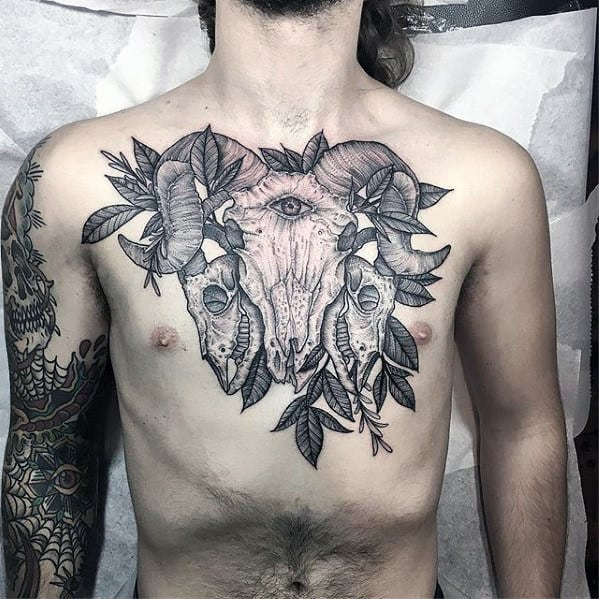 Guys Detailed Goat Skulls Chest Tattoo With Black And Grey Ink Design