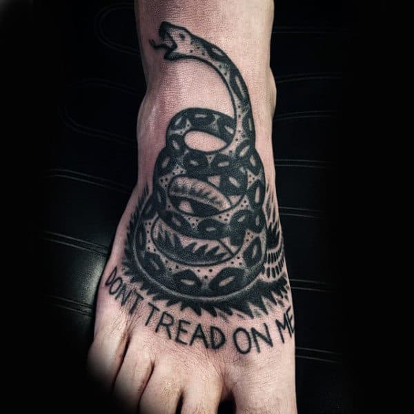 Guys Dont Tread On Me Text And Coiled Snake Foot Piece In Black Ink Tattoo
