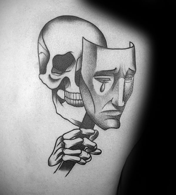 Guys Drama Mask Tattoo Deisgns With Skull And Skeleton Hand On Upper Back Shoulder Blade