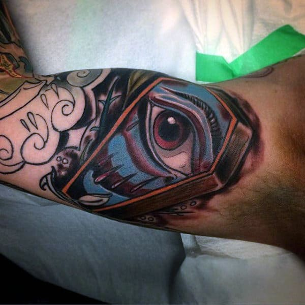 Guys Eye Coffin Tattoo Design On Bicep