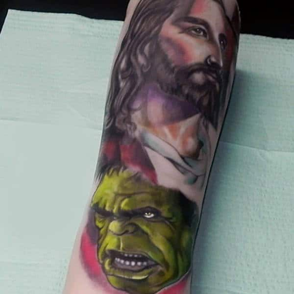 Guys Forearms Hulk And Religion Tattoo