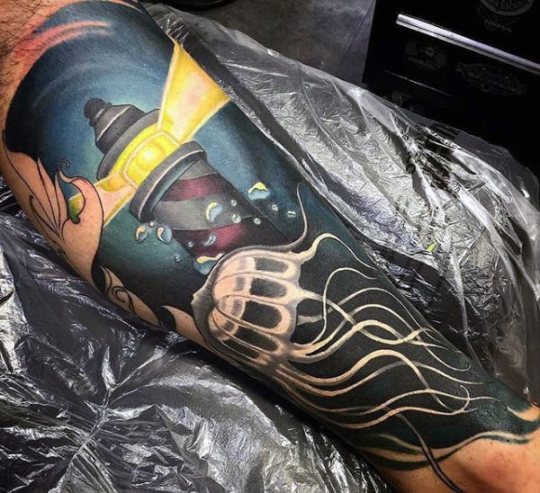 Guys Forearms Light House And Jellyfish Tattoo