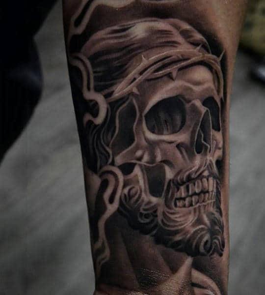 Guys Forearms Skull Religious Tattoo