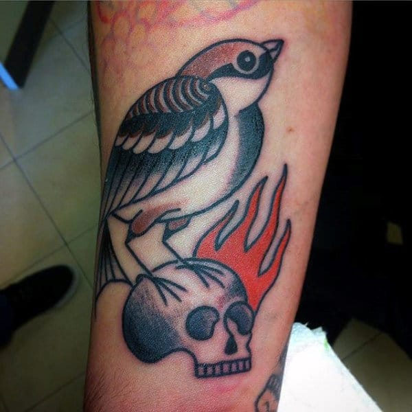 Guys Forearms Sparrow On Burning Skull Tattoo