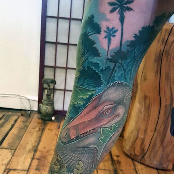 Guys Forearms Stunning Dinosaur In Green Forest Tattoo