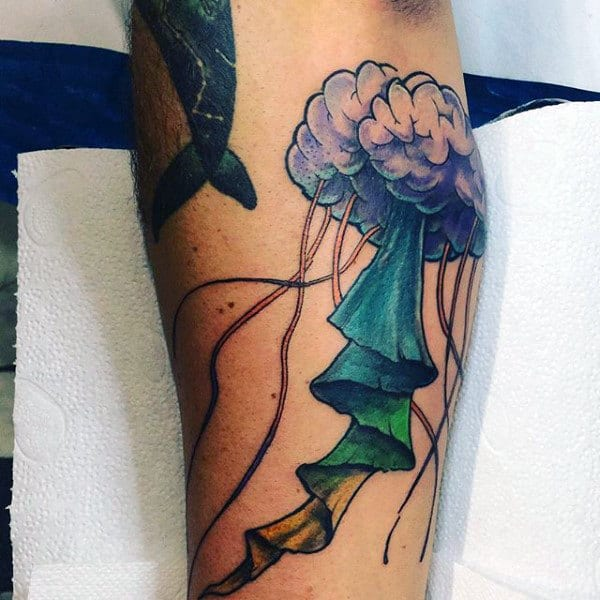 Guys Forearms With Folded Tentacled Jellyfish Tattoo