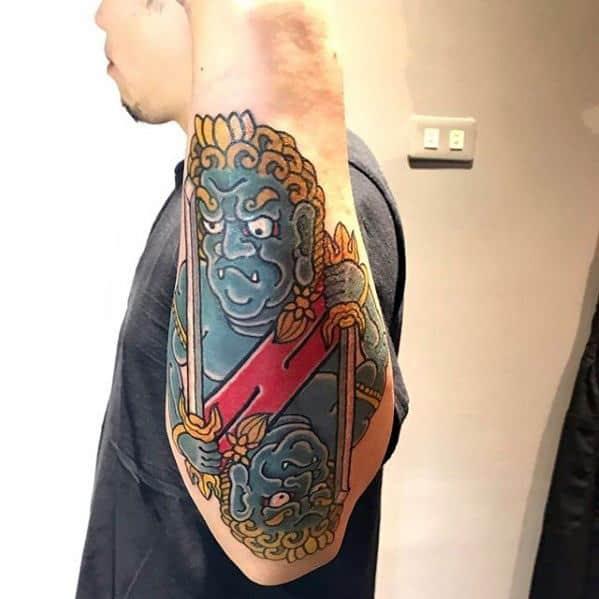 Guys Fudo Myoo Tattoos On Outer Forearm