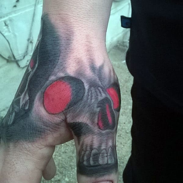 Guys Glowing Red Skull Thumb Tattoo