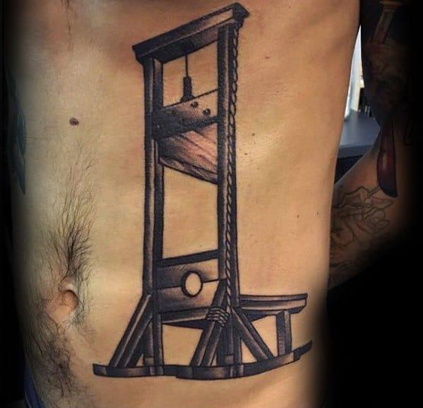 Guys Guillotine Tattoos