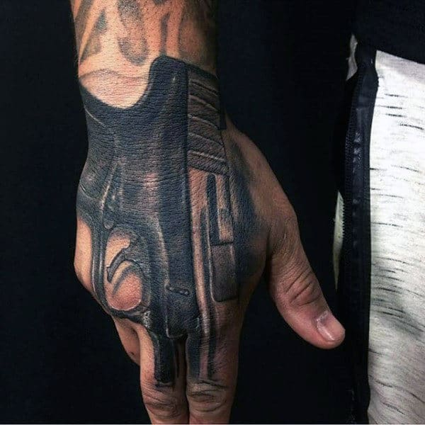 Guys Hand Grey Black Pistol Tattoo