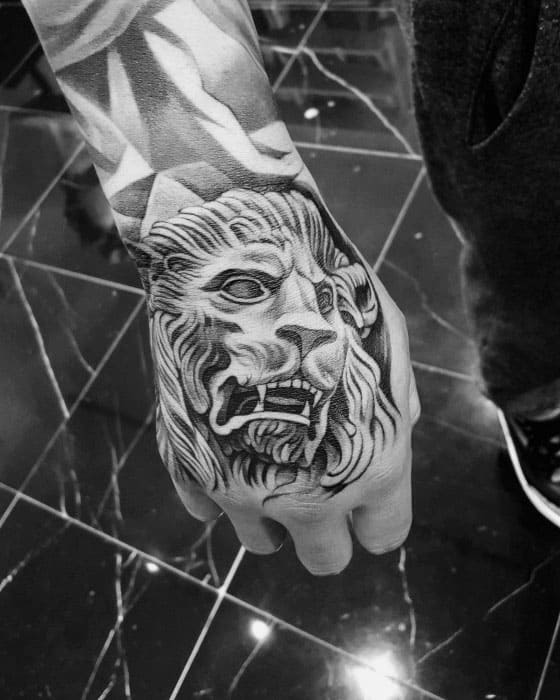 Guys Hand Shaded Lion Statue Tattoos