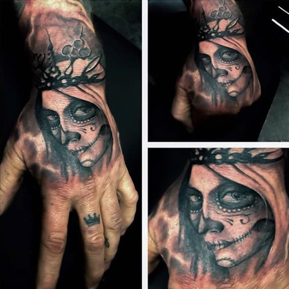 Guys Hands Crowned Female Day Of The Dead Tattoo