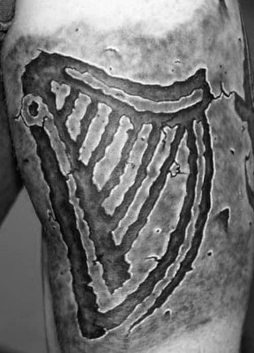 Guys Harp Tattoo Stone Design