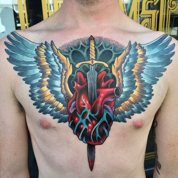 Guys Heart Tattoo Neo Traditional Style With Sword And Wings Chest Piece