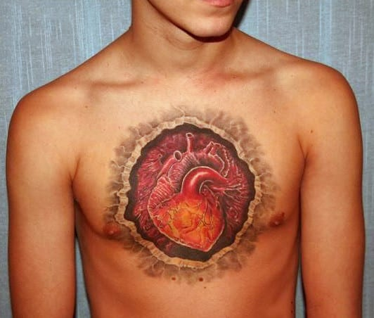 Guys Heart Tattoo On Burst Chest In Full Color