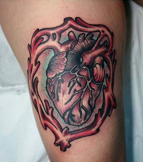 Guys Heart Tattoo With Border On Thigh