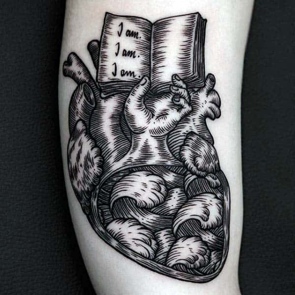 Guys Heart With Open Book Arm Woodcut Tattoo Designs