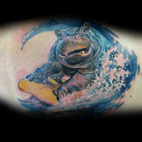 Guys Inner Arm Bicep Hippo On Surfboard With Waves Tattoos