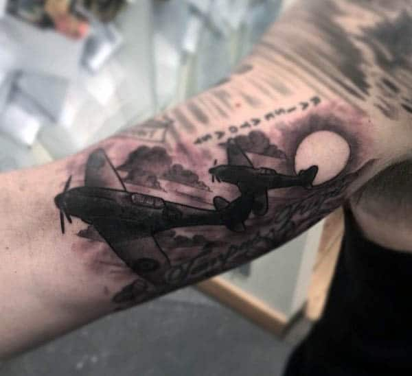 Guy's Jet Tattoo On Arm