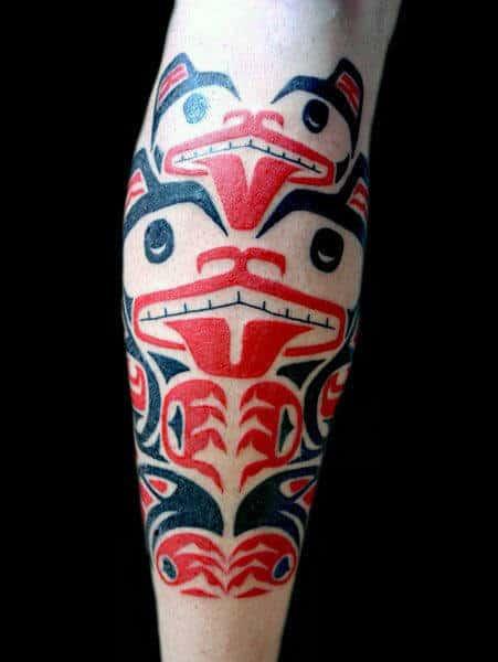 Guys Legs Red Black Haida Tattoo