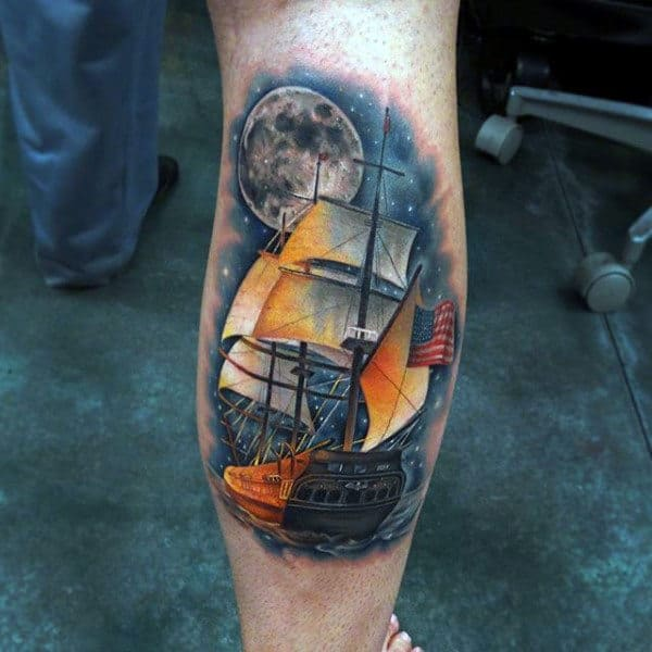 Guys Lower Legs Cool Yellow Sailed Ship With Moon Tattoo