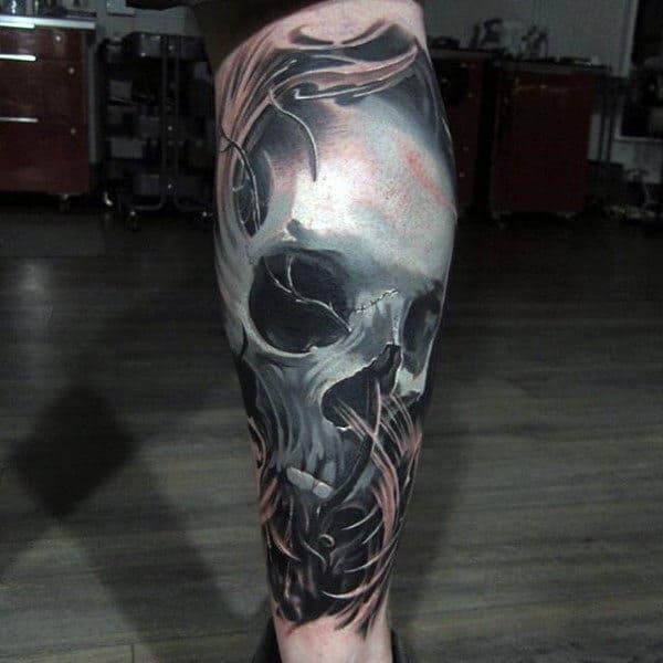 Guys Lower Legs Skull Tattoo
