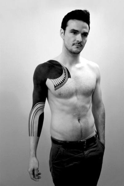 Guys Masculine All Black Chest And Sleeve Tattoo Inspiration