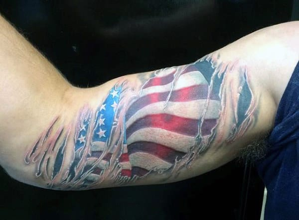 Guy's Military Flag Tattoo On Bicep