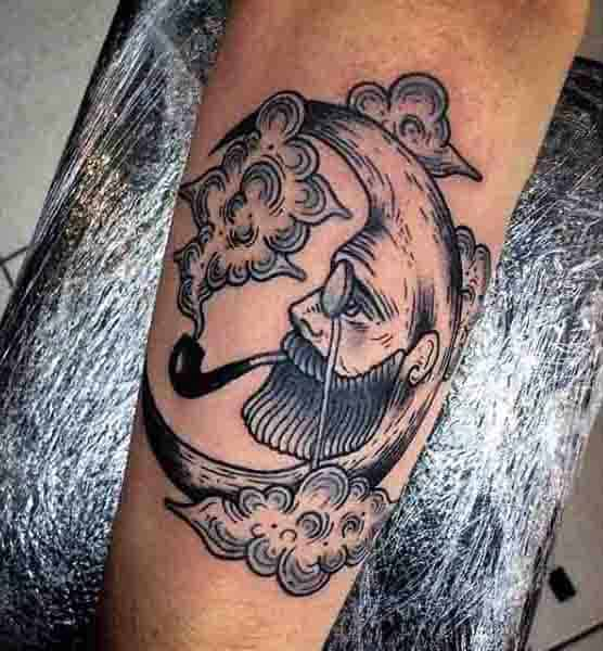 Guys Moon Face Tattoo With Smoking Pipe Design On Arm