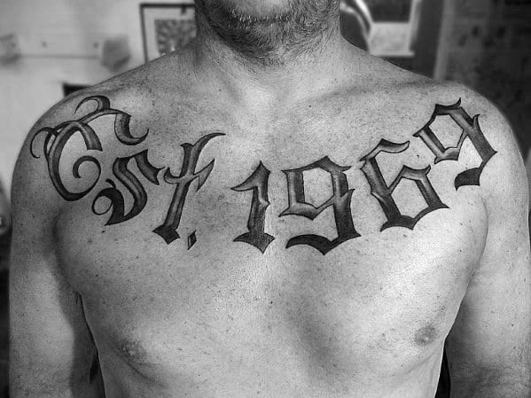 Guys Old Font Est 1969 Tattoo On Upper Chest